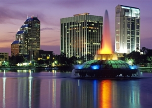 With glowing sunset as backdrop, downtown Orlando, Florida is reflected in mirror smooth Lake Eola.
